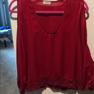 Red long sleeved, open arm shirt with lace detail